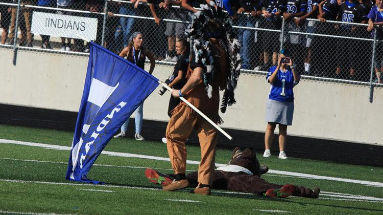 Justin Graves (12), the Indian, chases around a wolf in honor of the homecoming game against Michigan City. Staff and students participated in a dodgeball game, tricycle race and a softball game.