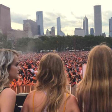 Lara Mitchell [middle] (12) stood in front of the crowd at Lollapalooza. Mitchell has gotten to meet various artists due to the backstage passes that she receives from her dad.