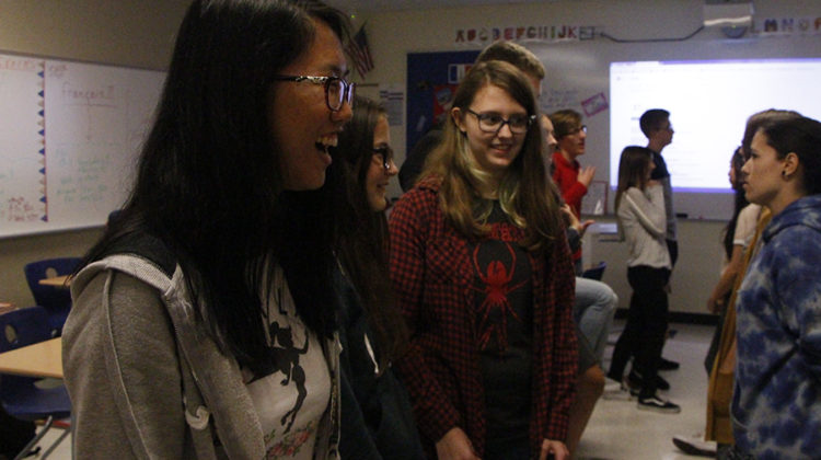 Jieying Chen (11) laughs at what a fellow French club student says. This was the first meeting of the year.