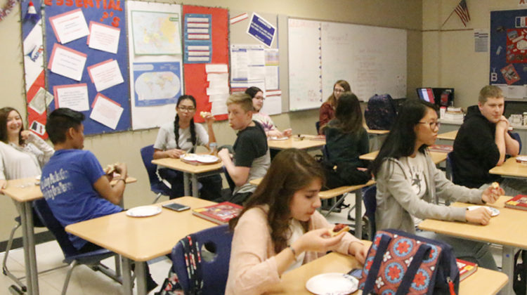 Students eat French treats at the end of the meeting. Treats included croissants, brioche bread and jellies.