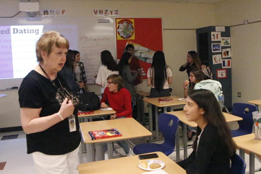 Ms. Bovard talks with a student about different French foods and treats. Ms. Bovard had been sponsoring French club for the last two years.