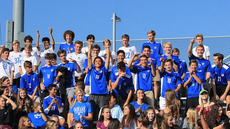 The soccer team stands up while they are recognized at the pep rally. All fall sports and clubs were recognized at this time