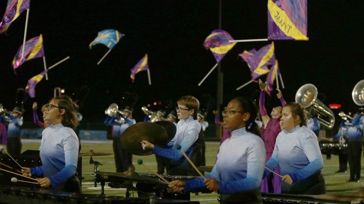 The percussion section finishes their performance during the final moments of the show. The band's performance symbolised friendship and making bonds.