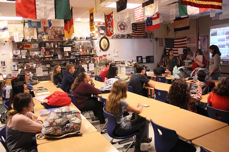 Students gather in Mr. Tom Clark's, Social Studies, room for an Interact Club meeting. The meeting only lasted about twenty minutes.