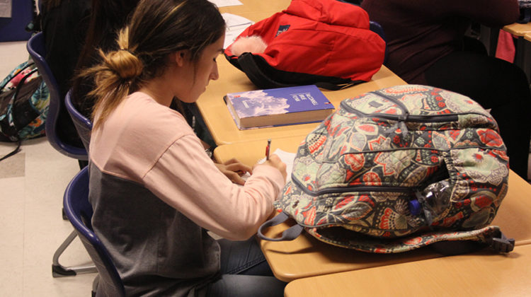 Katerina Petreska (12) signs in during the meeting. The next Interact Club meeting will be held on Oct. 17.