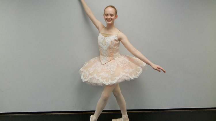 Amanda Willy (9) poses after rehearsing for her studio's annual gala. Willy has been dancing since she was about five-years-old.