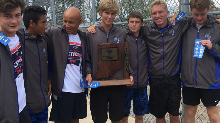 The boys cross country team poses with their Sectionals trophy. The team took first place at  Sectionals.