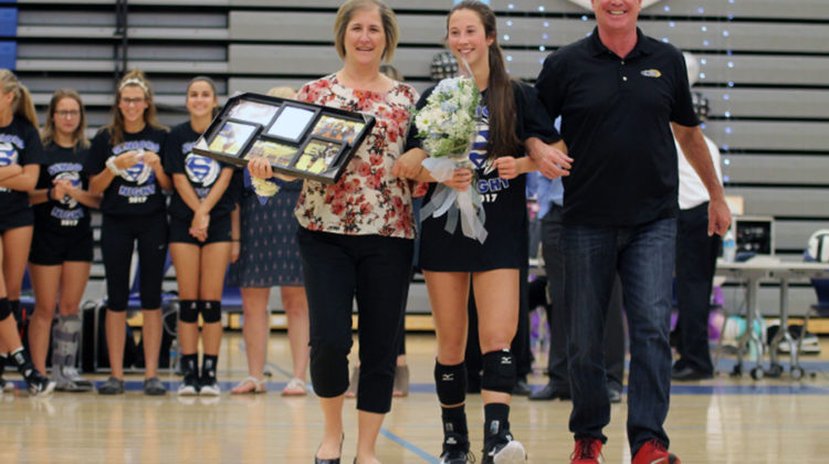 Mia Dinino (12) walks down the court with her parents. There were three seniors on the varsity team this year.