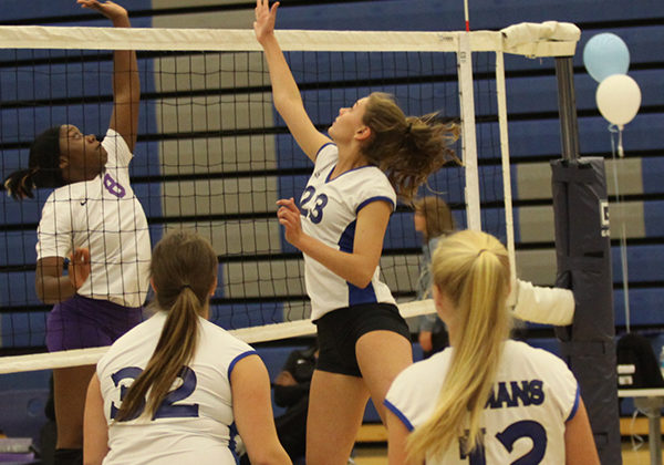 Joie Mulligan (9) makes a play with Jessica Toberman (10), Lily Robison (9) and  Gabby Sandoval (9) backing her up. Everyone worked together throughout the two matches to make many plays.