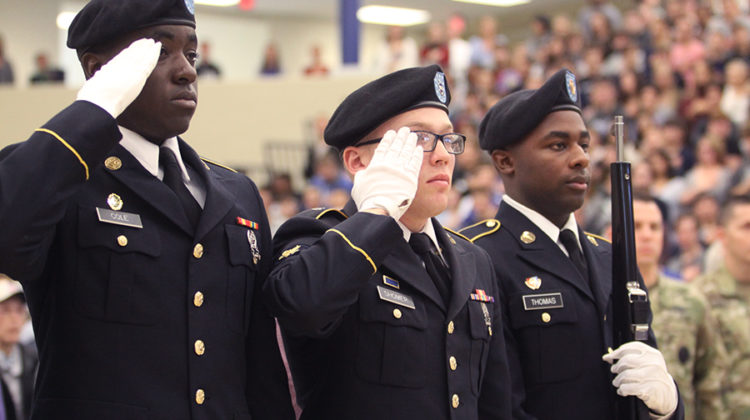 Members of the Indiana National Guard stand and salute during the National Anthem.  The members also brought in the state and national flags at the opening of the ceremony.