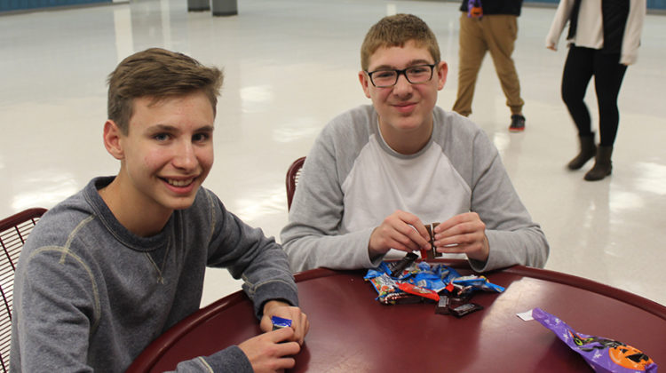 Joseph Lopez (10) and his buddy Ethan Snodgrass (9) count the candy they picked. They went trick or treating and found out they are buddies for the year.