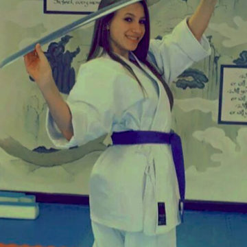 Ivana Miladinovic (11) is training hard, winning tournaments and anticipating the future.  A few years back, Miladinovic was training with a katana. Since then she has earned a higher belt rank.