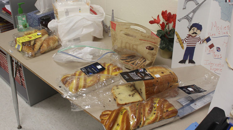 French bread and croissants sit out on a table. Members of French Club were invited to enjoy food and refreshments before and after the presentation.
