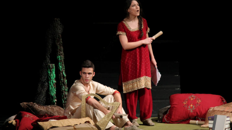 Theodore Karras (12), playing prince Amir and his mother, played by Vanessa Torres (12), discuss plans for the ball at the palace. The sets for the palace, forest and other locations in the play were done by nine volunteers.