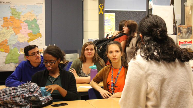 Students pay attention as officer, Erica Araujo (12), tells the story of Bloody Mary. They talked about spooky legends in the spirit of Halloween.