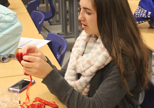 Mariya O'Grady (10) works on making the Veterans Day decorations for the veterans coming to the school.  The program is being held Nov. 9.