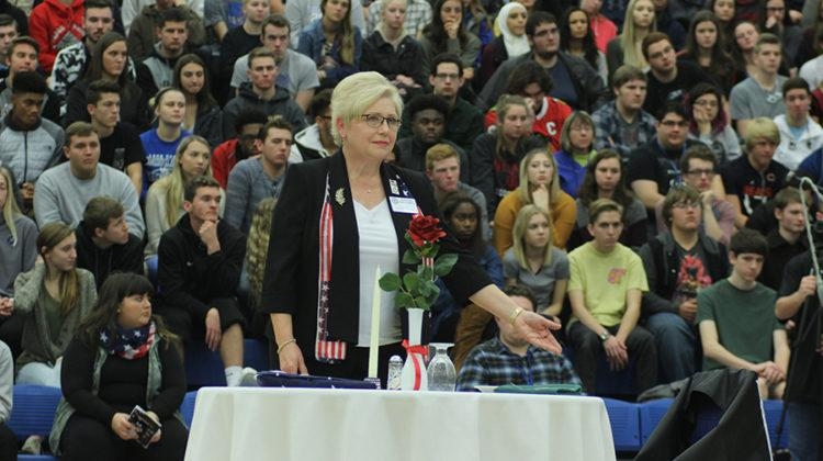 Rose Ann Dzieglowicz performs the POW MIA tribute. Dzieglowicz and her husband Marty performed the ceremony.