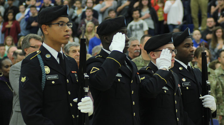 Members salute during the National Anthem. The assembly was hosted by History Club for the third consecutive year.
