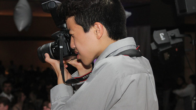 Joshua Chen (10) takes pictures during Prom. Chen was given the opportunity to join Publications as a freshman.