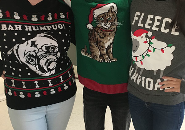 Hailey Kitchell (12), Nathaniel Tamez (12) and Erika Araujo (12) wear Christmas sweaters.  They wore these to get ready for the upcoming holidays.
