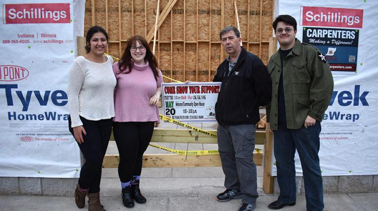 Alexis Nikolovski (12), Caitlin Mavity (12), Mr. Clark and William Morris ('17) stand with the unfinished Veterans Museum. The three students have helped fundraise and research for the museum.