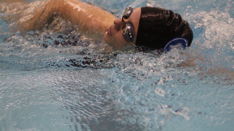 Emily Soeka (10) tries to beat her previous score. Soeka was super excited to swim today because it was her first meet.