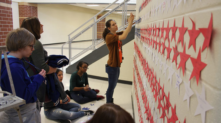 Members work together to complete Lake Central's veteran wall. This wall includes some of the names of veterans from the Vietnam war.