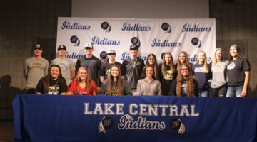 Lake Central senior athletes stand together on stage one last time as Lake Central athletes.
