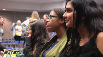 Sneha Shatish (12) and Ayanna Manyweather (12) listened to announcements. They were informed of upcoming events in history club.