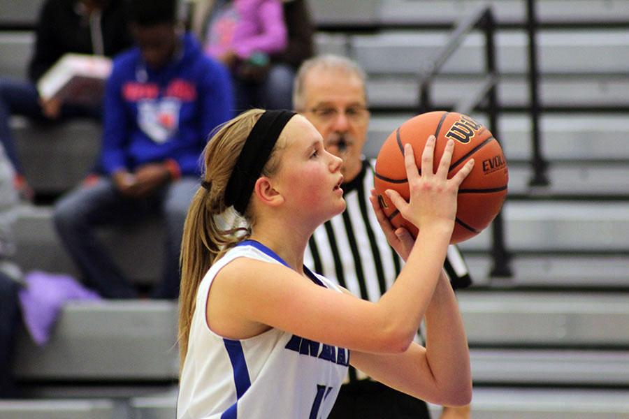 Makenna Hullinger (9) focuses before taking a free throw. Hullinger was able to make the shot.