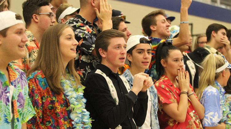 Lake Central students dressed in Hawaiian attire watch the game nervously. The fan section was filled with about 75 students.