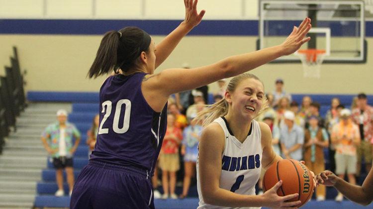 Lauren Ladowski (12) makes a last minute effort to score. Lake Central beat Merrillville 51-28.