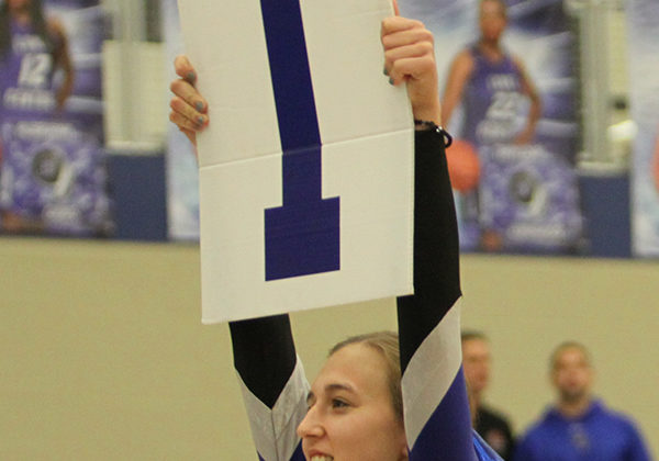 Molly Stokes (12) holds up a sign.The cheerleading squad cheered at the game.