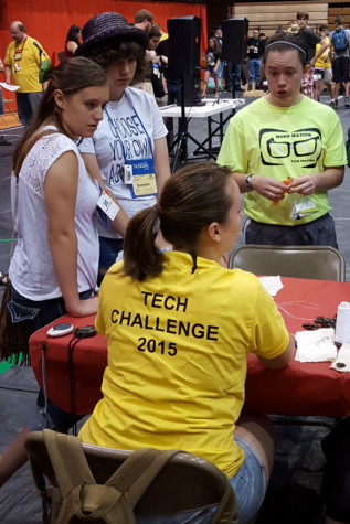 Brandilyn Stockton-Fresso ('15) speaks to a worker at the Tech Challenge competition. Stockton-Fresso was the first student from Lake Central to compete at the international level. Photo submitted by Mr. Ray Palasz, English.
