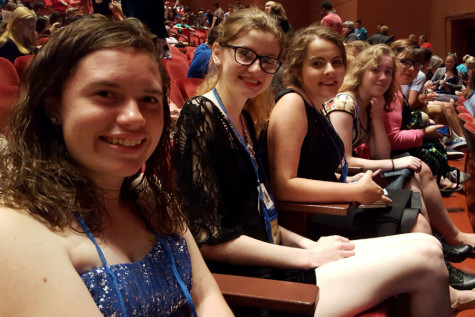 "Brandilyn Stockton-Fresso ('15), Nichole Heusmann (12), Madison Breford (12), Martha Mapes (12) and Monique Ochoa (12) prepare to watch ""White Christmas."" The show was one of six main stage productions that all of the delegates at the festival attended. Photo submitted by Mr. Ray Palasz, English.."