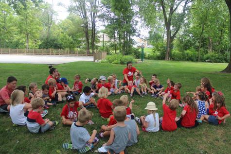 During camp, the kids gather in a circle to sing silly songs. There were 50 kids who attended Kiddy Kamp.
