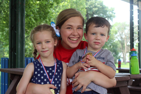 Katherine Morzy (10) poses with two campers on the last day of camp. This was Morzy's third year volunteering.