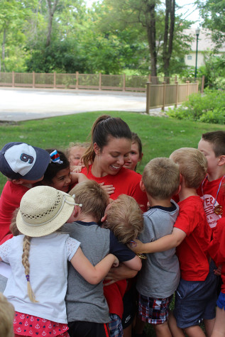 The kids gather around to give one last hug to Erin Kramer, camp director, on their last day of camp. Kramer has directed both camps for the last five years.