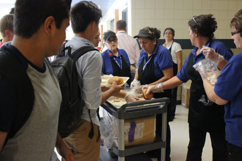 Members of the cafeteria staff hand out chicken sandwiches to students during D lunch. The staff was unable to make lunches because of a sewage problem on Monday, Sept. 26.