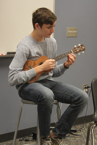 "Mason Crawford (11) sings and plays the ukulele to ""Can't Take My Eyes off You"" by Frankie Vallie and The Four Seasons. Crawford was appointed head of Open Mic Club this year."