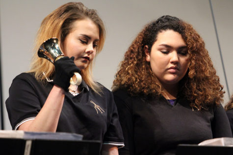 Taylor Lush (11) and Amanda Aponte(11) perform at the bells concert. Both students were in Bells II.