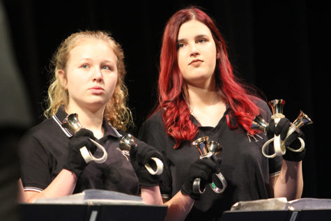 Brianna Rhomberg (9) and Madison Madgziarz (12) wait for their cue from their director. Rhomberg and Madgziarz were partnered up for the concert.