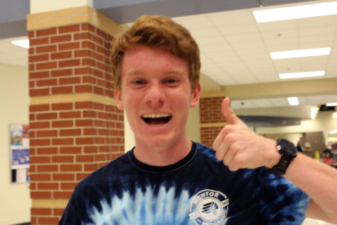 Carter Goldman (11) gives a thumbs up to signify the success of Open House. He was a volunteer who helped parents locate the classes they needed to go to.
